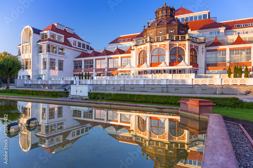 Baltic architecture of Sopot reflected in the fountain, Poland #71898482