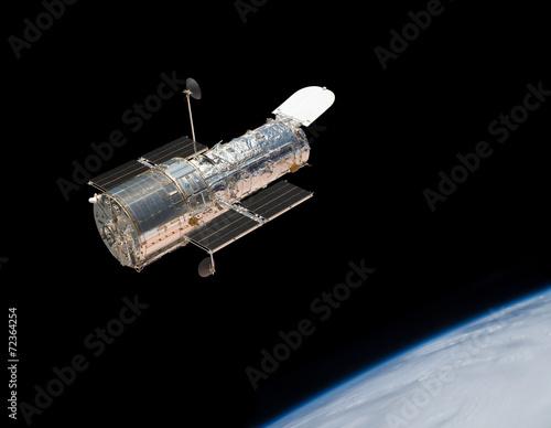 Hubble Space Telescope in orbit above the Earth.