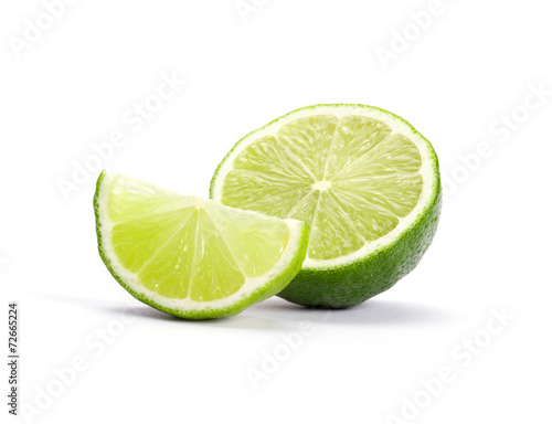 Photo Limes with slices isolated on white background