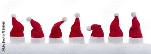 Photo 7 Weihnachtsmützen im Schnee