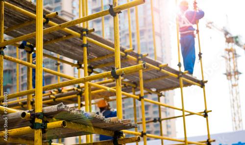 Photo working on scaffolding