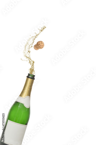 Cork popping out of champagne bottle
