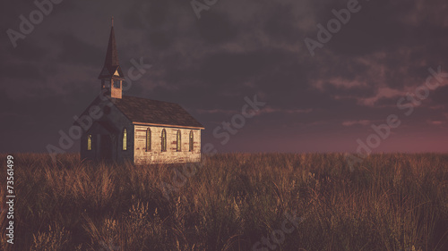Fotografija Old abandoned white wooden chapel on prairie at sunset with clou