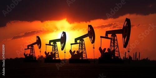 Fotografia Sunset on oilfield