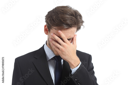 Obraz na plátne Worried or ashamed man covering his face with hand