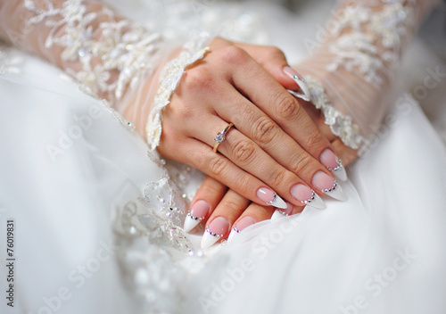 Canvas Print hands of a bride with a ring and a wedding manicure