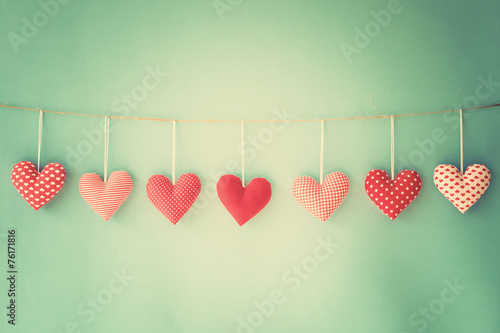Vintage cotton hearts hanging on a line