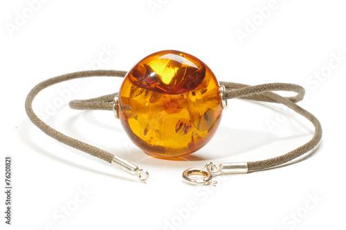 Big amber charm isolated on the white background Fototapeta
