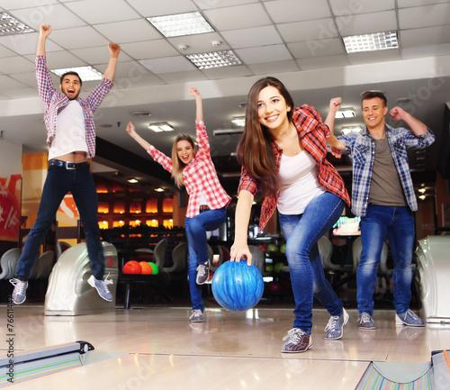 Fotografie, Obraz Friends playing in bowling club