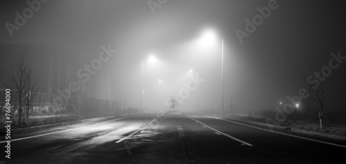 Stampa su Tela Black and white street at night with fog