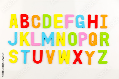 Alphabet magnets on whiteboard