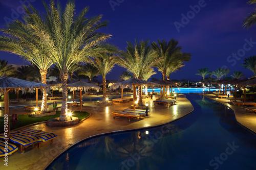 Fotografie, Obraz LuxuryTropical Resort Pool in dusk