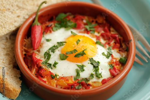 Eggs poached in tomato sauce and other vegetables