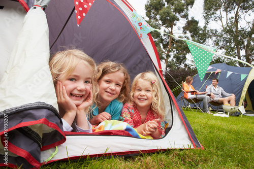 Family Enjoying Camping Holiday On Campsite Fototapeta