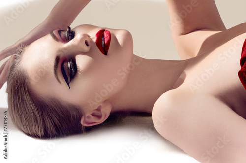Fotografia Beautiful young model with red lips. Gorgeous Woman Face.