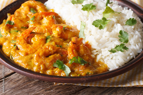 Shrimps in curry sauce with rice and cilantro horizontal