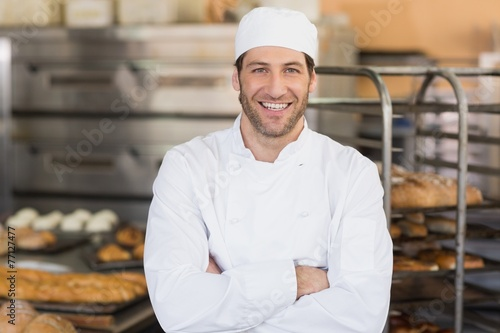 Smiling baker looking at camera Fototapete