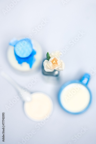 Still life with milk, dairy products,flowers, white tulips