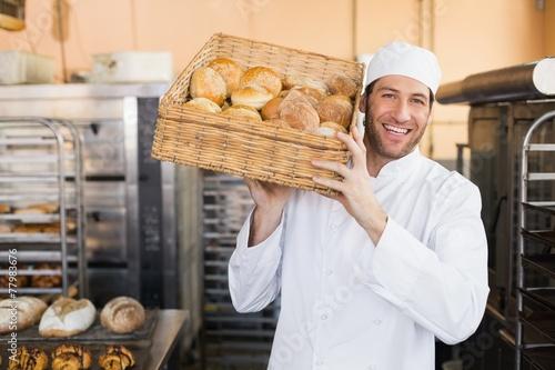 Murais de parede Baker holding basket of bread