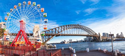Luna park wheel with harbour bridge arch in Sydney, Australia.