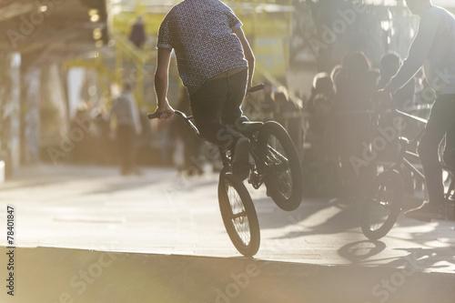 Anonymous bmx biker doing a stunt