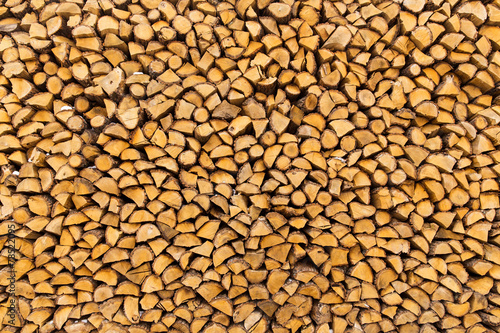 Pile of chopped firewoods #78522095