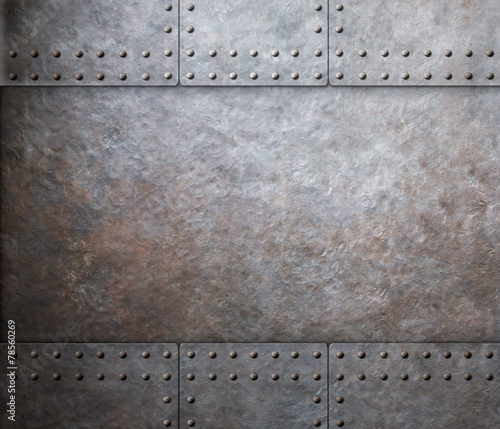 Fotografering steel metal armor background with rivets