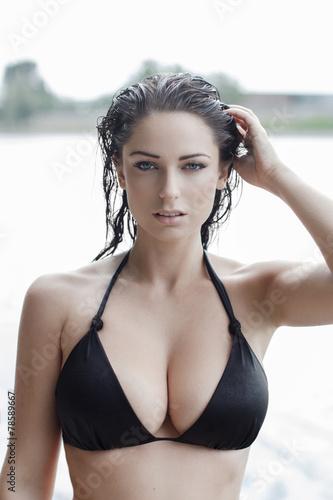 Fototapeta Sexy woman in bikini with wet hair and big tits