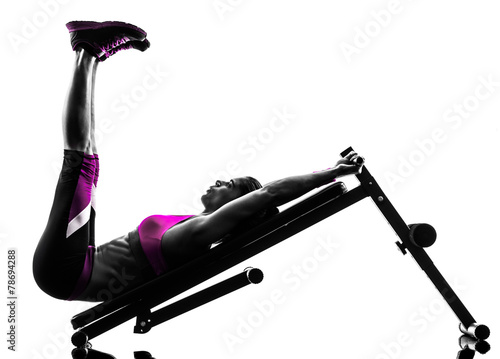 woman fitness  bench press crunches exercises silhouette