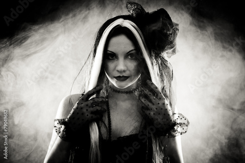 Portrait gothic girl in style clothes, shot over smoky backgroun