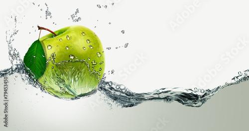 Green Apple amid splashing water. #79453450