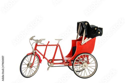 Obraz na plátně Red color vintage oriental rickshaw cab, miniature