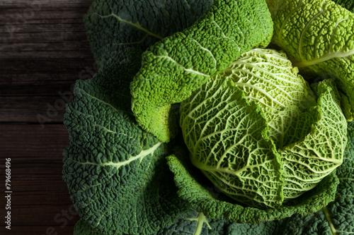 Fotografía Savoy cabbage superfood closeup on dark wooden backround