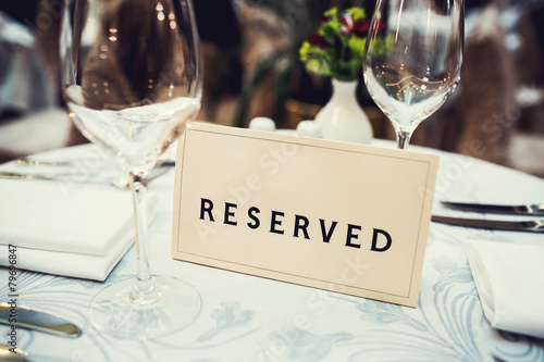 Reserved sign on a table in restaurant