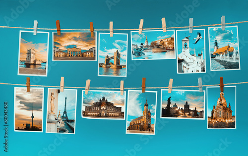 Pictures of european landmarks pinned on ropes, toned image