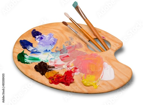Wallpaper Mural Artist. pallette with brushes on a white background