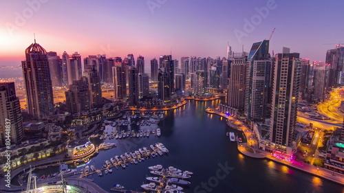 Dubai marina harbor panorama from night to day transition #80448837