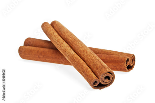 Foto Cinnamon isolated on white background