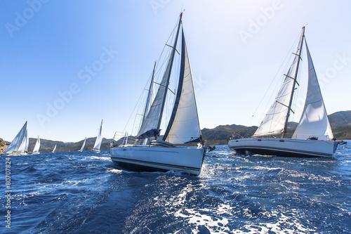 Sailing in the wind through the waves at the Aegean Sea. Fototapeta