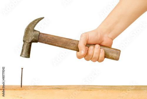 Wallpaper Mural Hammer and Nail Using hammer and nail on wood