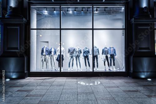 fashion shop display window and clothes. Fototapeta