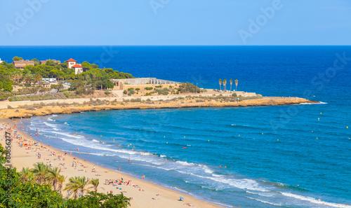Sandy beach of Tarragona in warm summer day