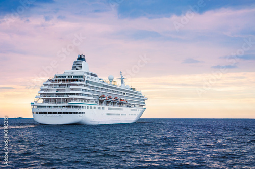 Fotografering Big cruise ship in the sea at sunset