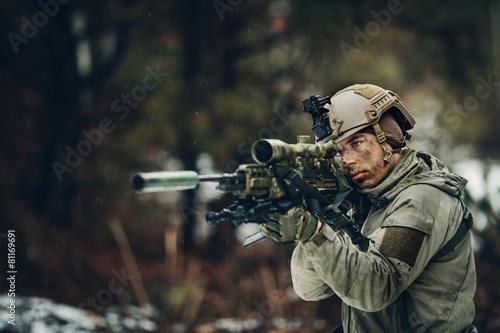 Obraz na plátně armed  man in camouflage with sniper gun