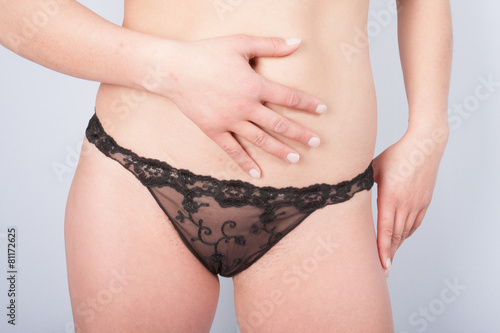Canvas-taulu A female hips and black panties