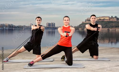 Stampa su Tela Three young people exercising