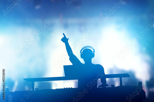 Club, disco DJ playing and mixing music for people. Nightlife