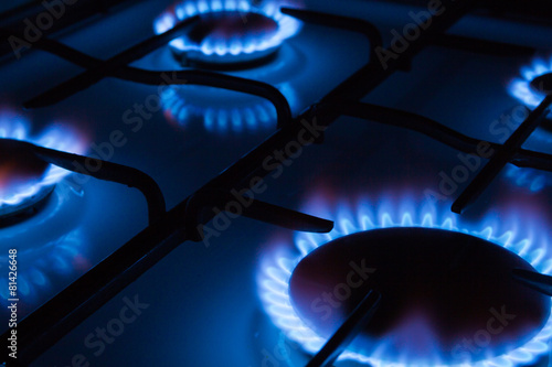 Slika na platnu Blue flames of gas burning from a kitchen gas stove