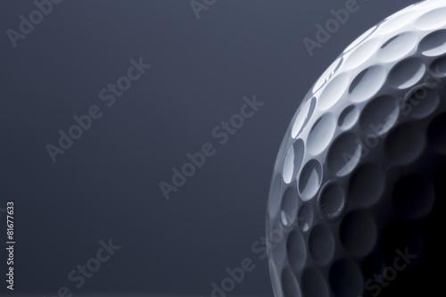 Tablou Canvas Stylish golf ball isolated on empty dark blue background.