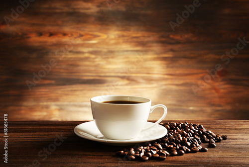 Cup of coffee with grains on wooden background #81865478
